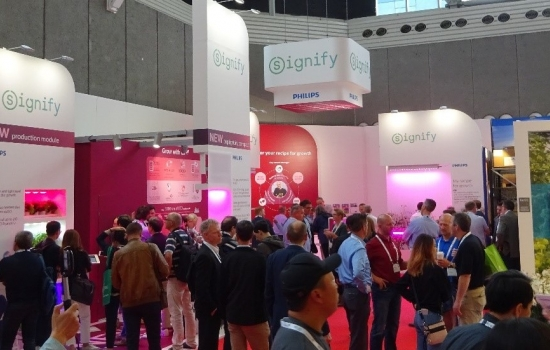 Inside a trade show event with people looking at exhibition stands
