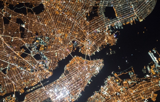 An arial view of a city lights at night