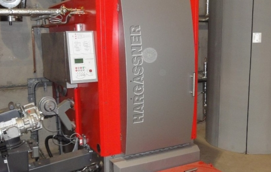 Biomass boiler in a shed