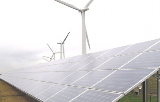 Solar panels with wind turbines behind