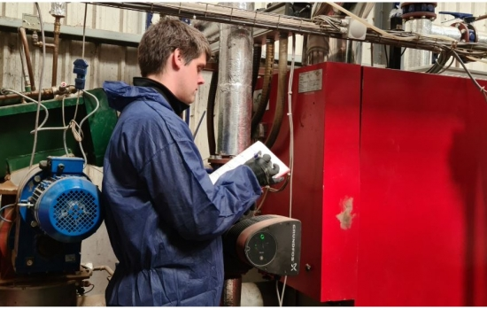 Engineer auditing pipework and machinery