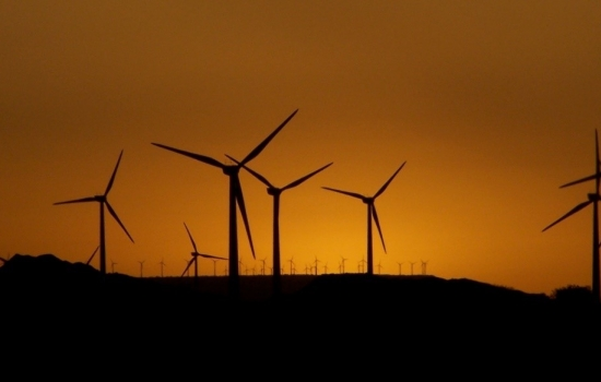 Silhouette of wind turbines in the sunset