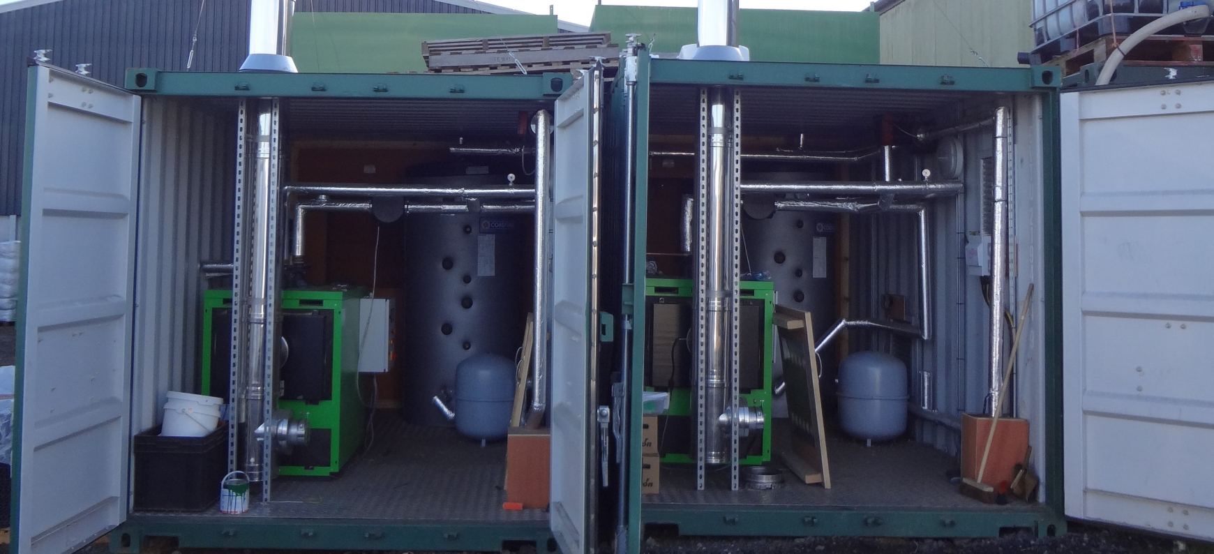Two green boilers in containers