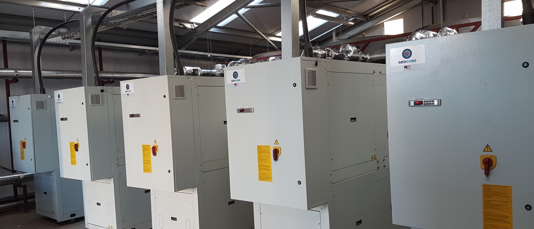 Five heat pumps in a large shed
