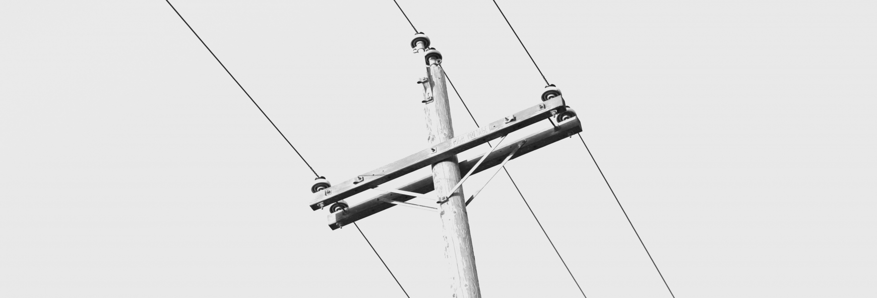 Black and white photo of electricity pylon