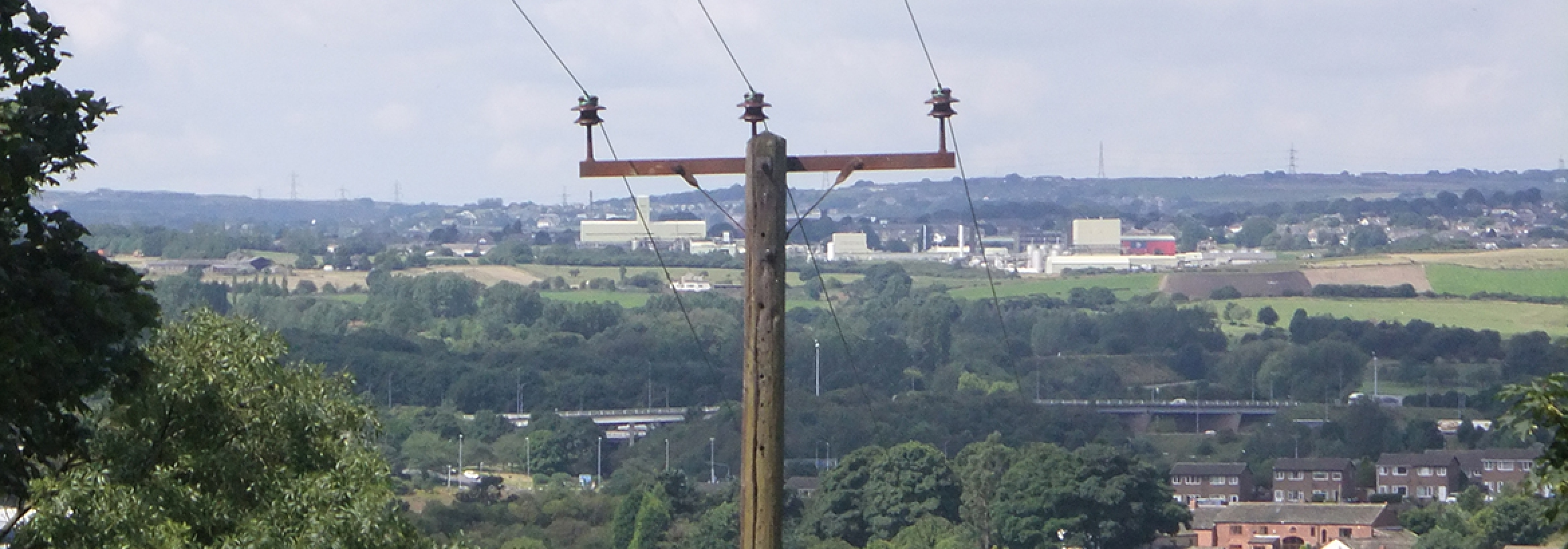 Electricity cables on pillars distributing energy representing NFU Energy's wayleaves and easements support service
